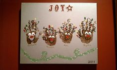 Handprint Holiday art. Spraypainted a canvas, added handprints ...