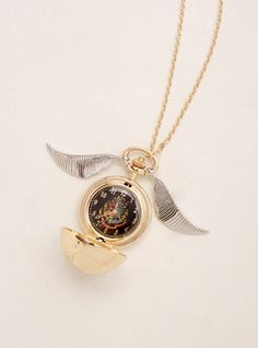 Unlike the Golden Snitch IRL, this necklace is easy to spot! The gold tone chain proves that you're the best Seeker around with a weighty gold tone Snitch pendant. Harry Potter Snitch, Locket Necklace, Pendant Necklace, Golden Snitch, You're Awesome, Bracelet Watch, Chain, Metal, Drinking Games