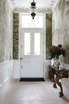 Entry hall in a Pembridge Gardens townhouse in London designed by Peter Mikic