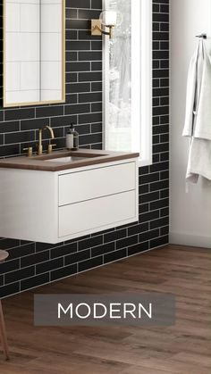 Home Discover Want to put a new spin on a classic style? Learn how by reading up on our modern trends in our latest Spring Catalog. Black Tile Bathrooms, Bathroom Tile Designs, Bathroom Trends, Modern Bathroom Design, Bathroom Interior Design, Tile On Bathroom Wall, Subway Tile Bathrooms, Bathroom Tile Patterns, Bathroom Mirror With Storage