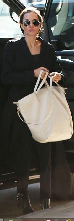 Who made Angelina Jolie's cream handbag and aviator sunglasses?