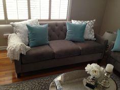 chloe macys sofa, aqua ikea pillows, white pillows and throw from zgallerie, ballard coffee table, smokey taupe benjamin moore paint.  grey sofa with aqua pillows