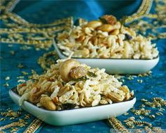 Chudwa, sometimes called chevda, is for South Indians what trail-mix is for us. It\'s a blend of nuts, dried fruit, puffed rice and various typical Indian spices.It\'s very easy to make, but like eggrolls, it\'s time-consuming. It\'s a big production. One of my sisters-in-law is in charge of assembling the ingredients. My mother-in-law is the one frying the puffed rice flakes. One other sister\'s job is to sprinkle the spices as soon as the ingredients are out of the oil. My job is to toss…