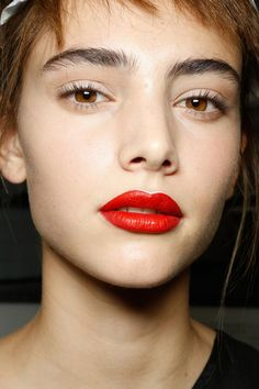 Prada Beauty S/S '13 // slim white highlights on inner rim and cupid's bow