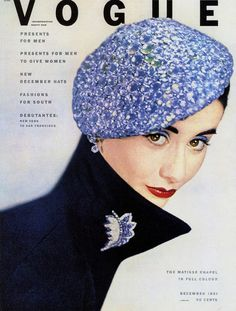 Beautiful shades of periwinkle and navy at work on a 1951 Vogue  December 1951 (by dovima_is_devine_II)