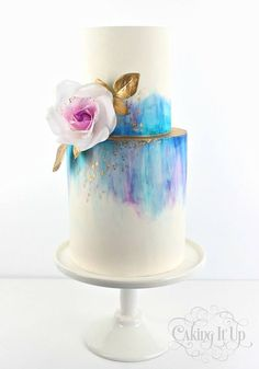 Caking It Up: {tranquil tones} Gorgeous blue and purple tones of watercolour featuring a delicate wafer paper rose and a splash of gold. I love the clean beauty of this cake. Gorgeous Cakes, Pretty Cakes, Cute Cakes, Amazing Cakes, Fondant Cakes, Cupcake Cakes, Fondant Tips, Bolo Drip Cake, Rodjendanske Torte
