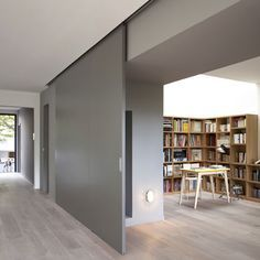 Modern Interior Design At Eco Sustainable House With White Oak Flooring And Grey Sliding Door As Room Divider Hide The Home Library Sliding Room Dividers, Sliding Wall, Wall Dividers, Paris Home, Nachhaltiges Design, Door Design, Murs Mobiles, Moving Walls, Movable Walls