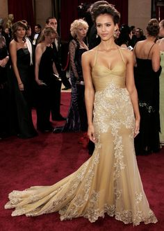 2006: JESSICA ALBA - Jessica was a true golden girl in this embroidered Versace gown. She complemented the look with an elegant updo and ove...