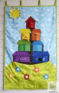 Love the combination rainbow blocks with different fastenings - house with fastenings over each window and a photo concealed in each