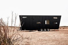 it sleeps up to six people, costs a little less than an airstream, can handle snow and is absolutely move-in-ready.