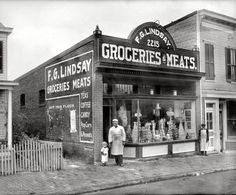 "Washington, D.C., circa 1925. ""F.G. Lindsay store front, Anacostia, 2215 Nichols Avenue."" Exterior of the grocery seen here. National Photo Co"