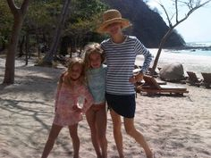 Beautiful sun smart Mom and daughters in Parasol while vacationing in Costa Rica