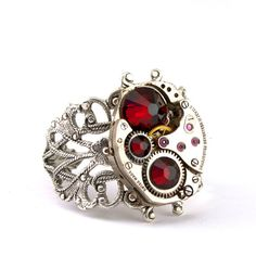 Steampunk awesome. Ring with red crystals.