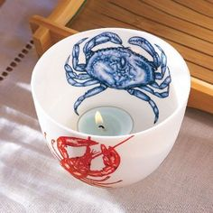 "Classic sea creatures bring this ceramic holder to life.  Satin matte glazed finish is food safe. 3"" h, 4"" diam."