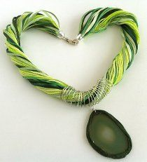 If you've always wanted to design your own gemstone jewelry, this Ribbon, Yarn, and Agate Slice Necklace is a great place to start gathering some inspiration. Donatella does it once again with this beautiful spring agate necklace. Make it in your favorite color!