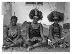 Three seated young women wearing items of clothing often worn during dances and ceremonial occasions. Manono, Samoa, 1893.