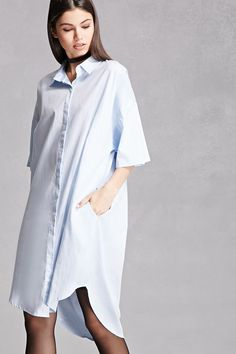 A woven shirt dress by Momokro™ featuring a button front, short dolman  sleeves,