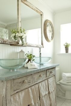 Save money by repurposing old tables for vanities and covering with remnant stone.  Use XL mixing bowls or old basins for sinks.