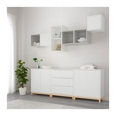 IKEA EKET cabinet combination with legs. THIS IS AMERICAN WHERE WE CAN'T HAVE NICE THINGS BECAUSE SOME PARENTS COULDN'T BOTHER TO SECURE THEIR DRAWERS TO THE WALL.