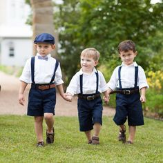 Super cute page boy-inspired ring bearers from a Hill Country, TX wedding. Photo by: Loft Photographie