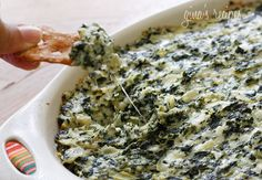 Hot Spinach and Artichoke Dip - Bring this hot spinach and artichoke dip to your next football party, no one will know it's light!