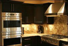 Dark cabinets with light translucent countertops