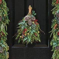 decorate your door with lovely a natural pre lit christmas door swag it features - Natural Outdoor Christmas Decorations