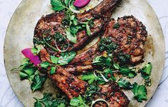Mint and Cumin-Spiced Lamb Chops:  2 med onions,  1 c cilantro,  1 c flat-leaf parsley,  1 c mint,  1 tbs cumin,  1 tbs paprika,  2 tsp allspice,  1 tsp red pepper flakes,  1 tsp ras-el-hanout or garam masala,  24 untrimmed lamb rib chops (about 5 lb.)Lamb can be marinated 12 hours ahead. Keep chilled.