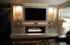 New elegant, modern, linear fireplace with floating tv wall. Beautiful! Jkappeconstruction.com Seattle contractor