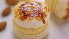 Recipe with video instructions: You've mastered macarons but check out this awesome decorating hack! We've given ours a Crème Brûlée twist! Ingredients: 125g icing sugar, sieved, 75g fine ground almonds, sieved, 2 egg whites, Pinch of salt, 50g caster sugar, Buttercream filling, 125g icing sugar, 4 tsp custard powder, 1 tsp vanilla bean paste, 75g soft unsalted butter, 1 1/2 tsp boiling water (from recently boiled kettle), Dulce de leche, Granulated sugar, Simple syrup, to ...