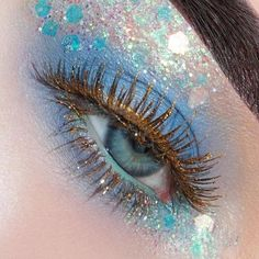 Blue eyeshadow and glitter makeup