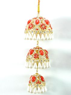 This lovely gold plated Kalire with Red stones and pearl drops will be perfect for your wedding. These are delicate yetheavy, handcrafted with intricate semi p