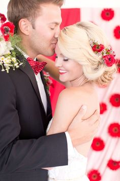 Romantic Bridal Updo with Red Flowers and a Floral Backdrop | Amy and Jordan Photography | http://heyweddinglady.com/retro-glam-wedding-shoot-poppy-red-gold/
