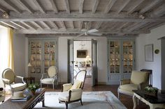 We have been talking about painting the beamed ceiling in our living room.  This certainly looks inviting.