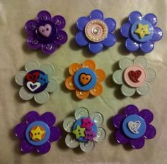 Flip Off Cap Badges...so easy and fun to make! Simply hot glue the flip off caps together to make a flower and decorate as desired! :)