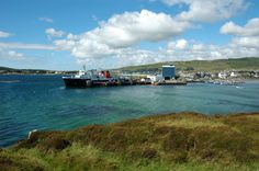 A nice view of Port Ellen from the Ard, the pier with the (now former) Islay ferry MV Isle of Arran in the centre. On the right Port Ellen Marina. Behind the ferry you can just see the Port Ellen M...