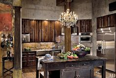 Gerard Butlers kitchen. I love the rustic look.