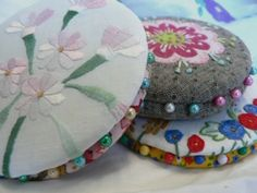 Pinwheels are a great way to store your pins,  especially for traveling because the pins don't stick in to you or spill. They are also a cool way to repurpose a doiley or fragment of some special textile.