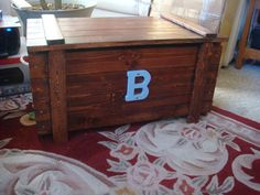 Custom Toy Box / Blanket Chest monogram by OakNacorn on Etsy, $99.00 - We opted to paint an old toy box from storage to match the room. Worked very well!