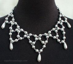 Michaela Renaissance Medieval Tudor Elizabethan German Festoon Necklace www.sapphireandsage.com Suitable for any period re-enactment, but especially workable for an early period/Medieval persona.  Silky-smooth 8mm round glass pearls, with 18x7 tear drop pendants.