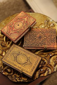Writing journals with metal clasps, edge printing and beautiful elaborate covers www.paperblanks.com