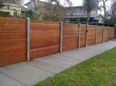 Wooden fence with metal posts