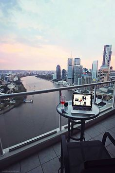 QLD – Brisbane, Queensland, Australia. A view towards the south along the Brisbane River. The dark building in the centre is Waterfront Place at 1 Eagle St. The tall building on the right is the Oaks Aurora Tower apartment hotel at 420 Queen St. The view is from the River Place Apartments at 82 Boundary St. @ Ivory St. https://www.google.ca/maps/place/River+Place+Apartments/@-27.4642856,153.0297683,17z/data=!4m5!3m4!1s0x6b9159f436ab8805:0x8cf2e90d5e4fbe33!8m2!3d-27.462453!4d153.03362