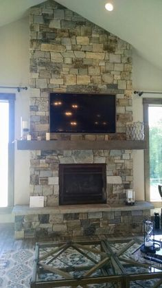 Fireplace with tv above, vaulted ceiling                              …