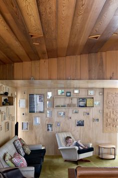 Plywood walls are covered with family photographs.