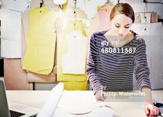 Stock Photo : Seamstress working at table