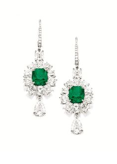 PAIR OF EMERALD AND DIAMOND PENDENT EARRINGS. Each suspending a cushion-shaped emerald weighing 2.81 and 3.72 carats, surrounded by cushion-shaped diamonds altogether weighing approximately 11.25 carats, supporting a pear-shaped diamond weighing 0.96 and 0.94 carat respectively, mounted in platinum.