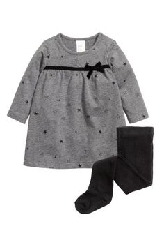 Jersey dress and fine-knit tights in organic cotton. Dress with a printed pattern, velvet ribbon trim at top with decorative bow, snap fasteners at shoulders, and long sleeves. Tights with elasticized waistband. Baby Girl Dresses, Baby Outfits, Baby Dress, Little Girl Fashion, Fashion Kids, Toddler Girl, Baby Kids, H&m Baby, Frocks For Girls
