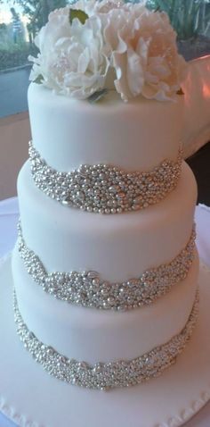 White Wedding Cakes love this cake! - Glam wedding cakes are one of the hottest 2014 wedding trends, and I just adore them! Such cakes are better for a formal celebration, of course, but even at a more informal wedding such a cake would look great. Bling Wedding Cakes, Wedding Cake Pearls, White Wedding Cakes, Elegant Wedding Cakes, Wedding Cake Designs, Trendy Wedding, Purple Wedding, Wedding Favors, Bling Cakes