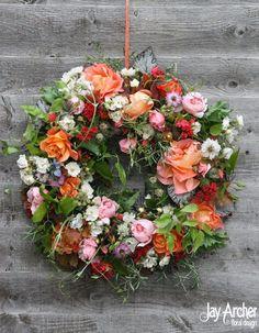 Summer wedding wreath of all homegrown old mans beard, roses, nigella, begonia, poppy foliage and heuchera